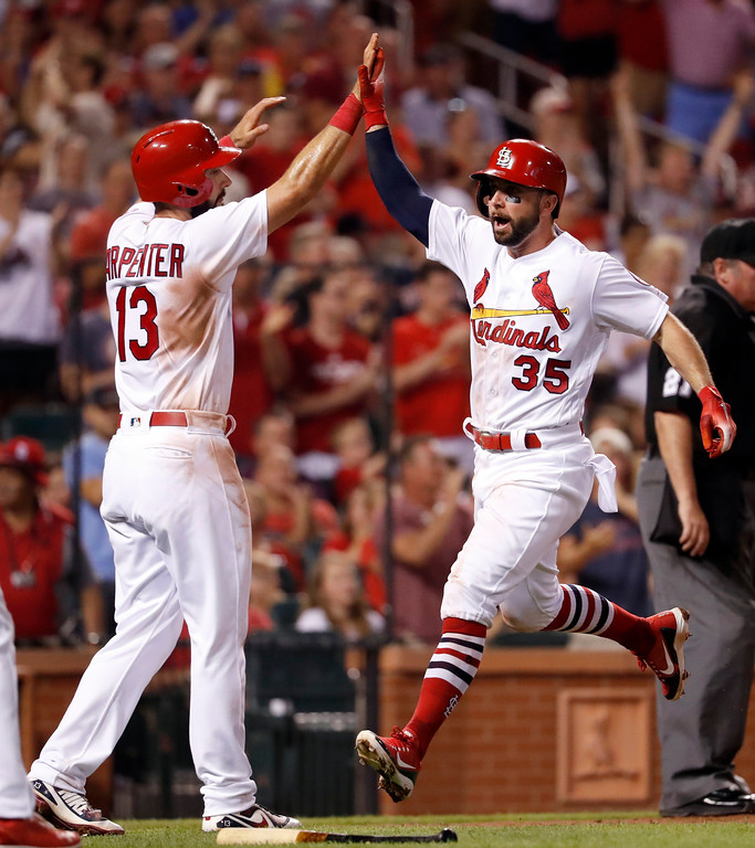 . St. Louis Cardinals\' Greg Garcia (35) celebrates with Matt Carpenter (13) after scoring on a two-run double by Marcell Ozuna during the third inning of a baseball game against the Cleveland Indians Monday, June 25, 2018, in St. Louis. (AP Photo/Jeff Roberson)