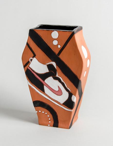"4.Nike shoe vase, terra cotta, hand built, under glaze:  h. 8.25"":  w.5.5"", d. 2.5"""