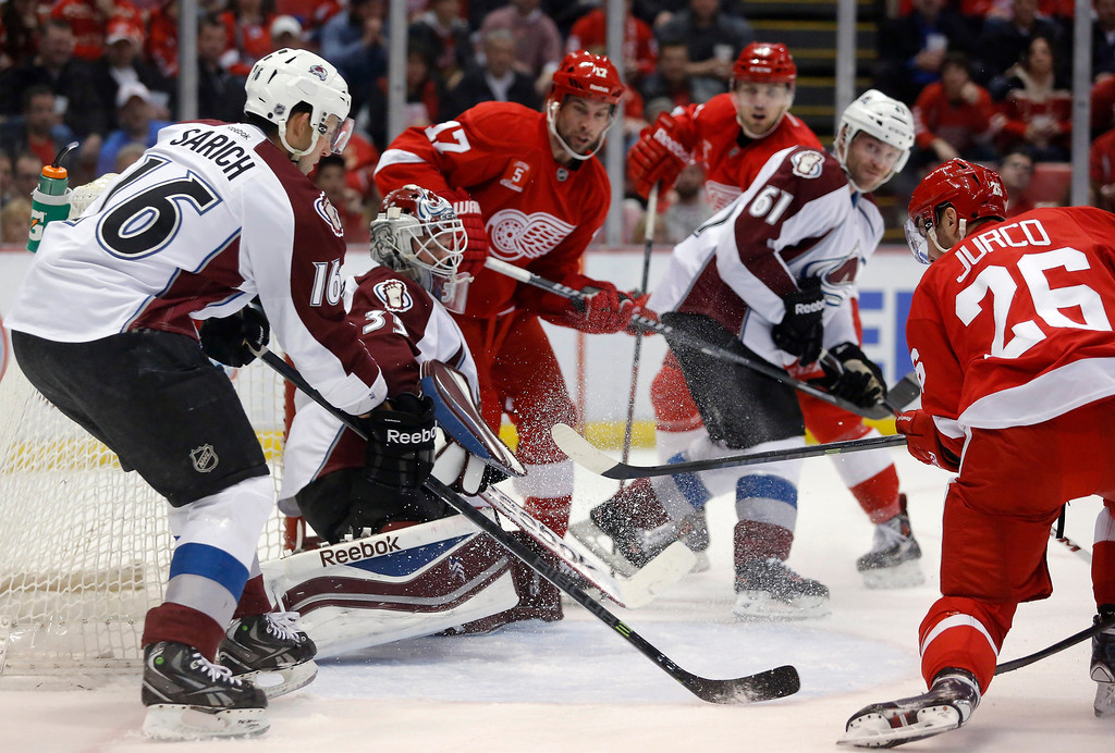. Detroit Red Wings\' Tomas Jurco (26) scores against Colorado Avalanche goalie Jean-Sebastien Giguere (35) as Colorado Avalanche\'s Cory Sarich tries to defend the goal during the second period of an NHL hockey game Thursday, March 6, 2014, in Detroit. (AP Photo/Duane Burleson)