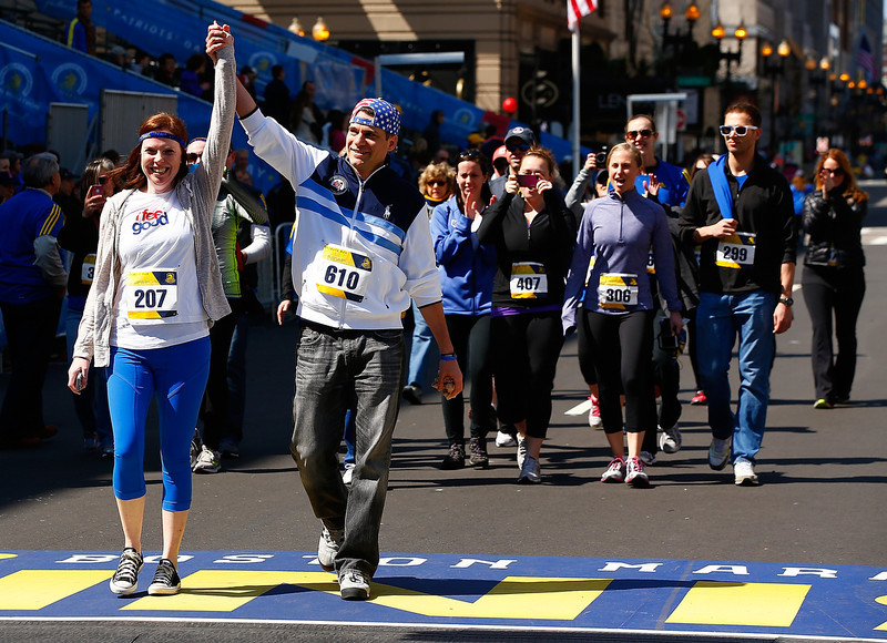 . Stephanie Benz and Cliff Demattia react after crossing the Boston Marathon finish line during the B.A.A. Tribute Run on April 19, 2014 in Boston, Massachusetts.  (Photo by Jared Wickerham/Getty Images)