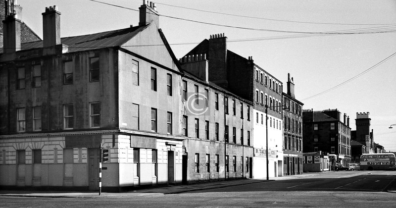 West St, east side south of  Kingston St.   The 5 storey building was a grain store (1887). The tower in the distance (1896) belonged to the Victoria Grain Mills, another of the few old buildings in the area spared demolition.     June 1975