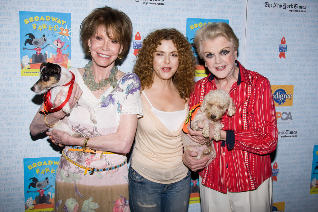 . Actresses Mary Tyler Moore, Bernadette Peters and Angela Lansbury pose with dogs up for adoption at Broadway Barks 11 in New York, Saturday, July 11, 2009. (AP Photo/Charles Sykes)