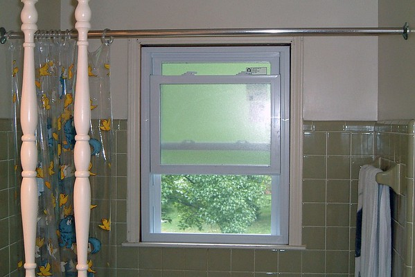 July 23, 2004:  A new window and sliding door .  .  .