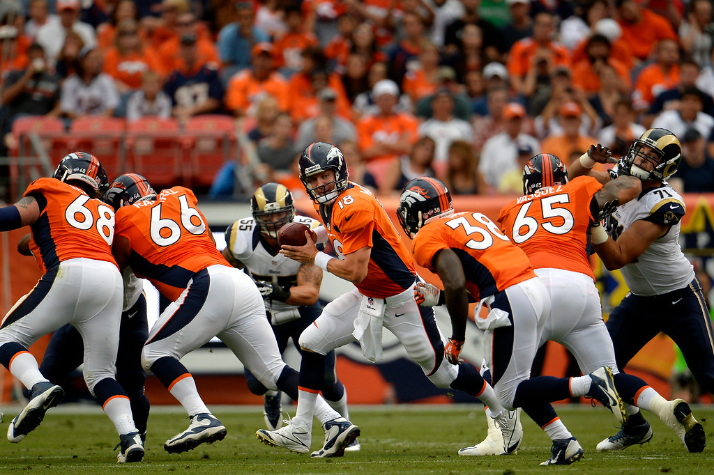 . DENVER, CO. - August 24: The quarterback Peyton Manning (18) of the Denver Broncos vs the St. Louis Rams during the first half of the 3rd pre-season game of the season at Sports Authority Field at Mile High. August 24, 2013 Denver, Colorado. (Photo By Joe Amon/The Denver Post)