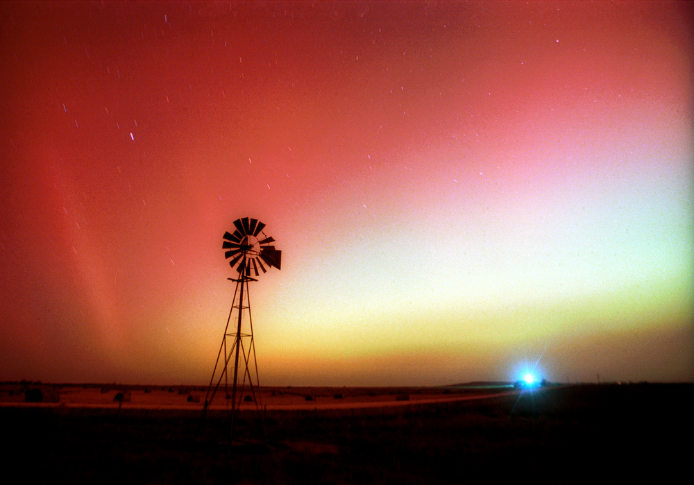 Description of . The aurora borealis illuminates the night sky Monday, Nov. 5, 2001,  near Ellis, Kan., during a spectacular show not commonly seen in Kansas. The displays are associated with an interaction between the solar wind, a continuous flow of electrically charged particles from the sun, and the earth's magnetic field. (AP Photo/Hays Daily News, Steven Hausler)