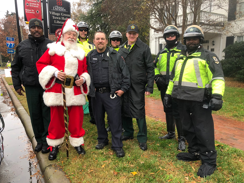 Santa hanging out with college and county's finest law enforcement officers before the start of the parade.