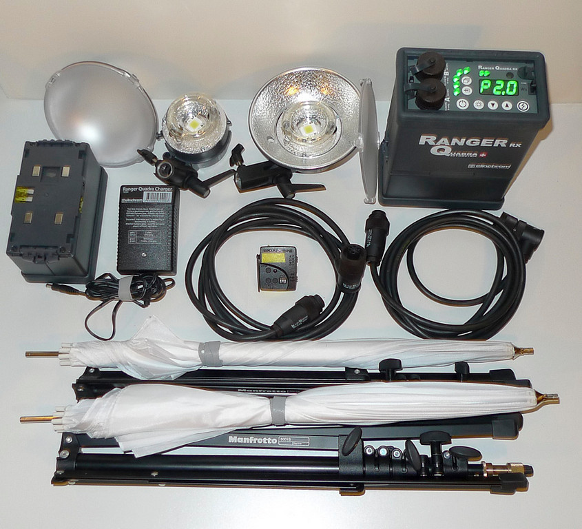 Two 400ws strobes with reflectors and reflector protectors. One Ranger Qundra power pack attached to battery pack.  Back up battery pack, charger, radio trigger remote, two cables. Two umbrellas, two Manfrotto Nano compact light stands. http://www.elinchrom.com/sets.php?base_set=42  http://www.manfrotto.com/product/8373.16112.76935.0.0/5001B/_/NANO_BLACK_STAND