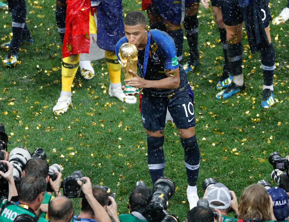 . France\'s Kylian Mbappe kisses the trophy after the final match between France and Croatia at the 2018 soccer World Cup in the Luzhniki Stadium in Moscow, Russia, Sunday, July 15, 2018. (AP Photo/Frank Augstein)