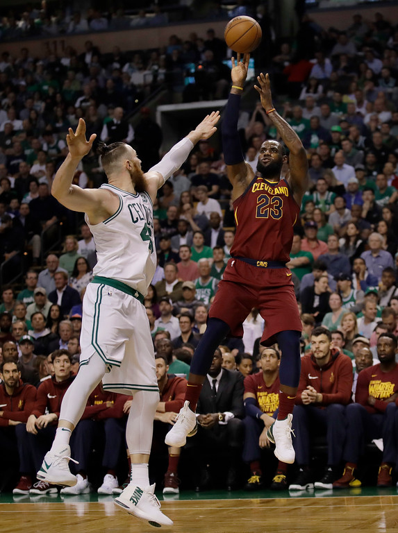 . Cleveland Cavaliers forward LeBron James, right, shoots over Boston Celtics center Aron Baynes during the first half in Game 2 of the NBA basketball Eastern Conference finals Tuesday, May 15, 2018, in Boston. (AP Photo/Charles Krupa)
