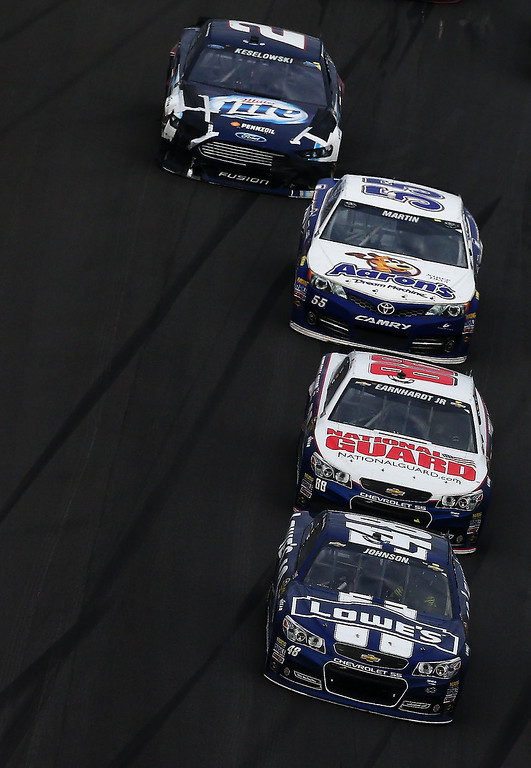 . Jimmie Johnson, driver of the #48 Lowe\'s Chevrolet, leads the field during the NASCAR Sprint Cup Series Daytona 500 at Daytona International Speedway on February 24, 2013 in Daytona Beach, Florida.  (Photo by Jonathan Ferrey/Getty Images)