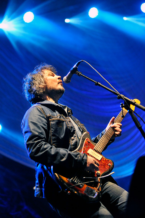 """. Wilco frontman Jeff Tweedy is bathed in blue lights during an all covers set Friday at the 2013 Solid Sound Festival at MASS MoCA in North Adams, Mass. The evening\'s highlights included The Beatles\' \""""And Your Bird Can Sing\"""" and Dylan\'s \""""Simple Twist of Fate.\"""" (Peter Crabtree/Bennington Banner)"""
