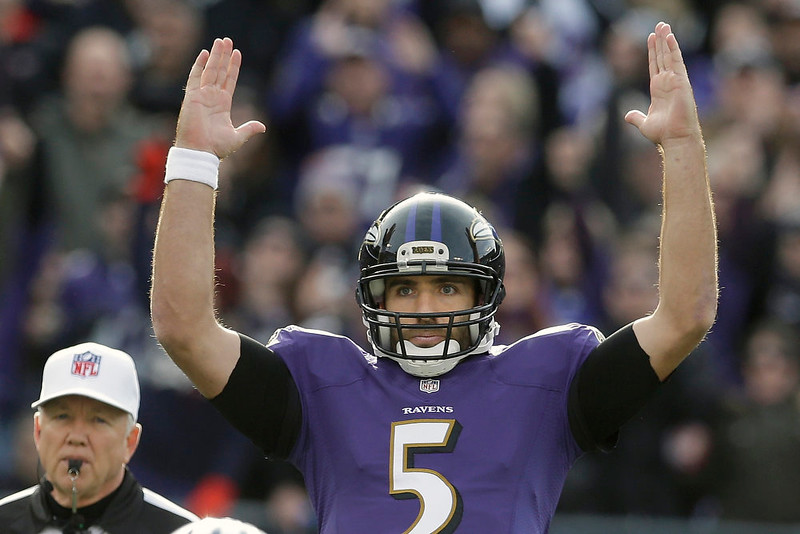 . Baltimore Ravens quarterback Joe Flacco (5) reacts to running back Justin Forsett\'s touchdown during the first half of an NFL football game against the Tennessee Titans in Baltimore, Sunday, Nov. 9, 2014. (AP Photo/Patrick Semansky)