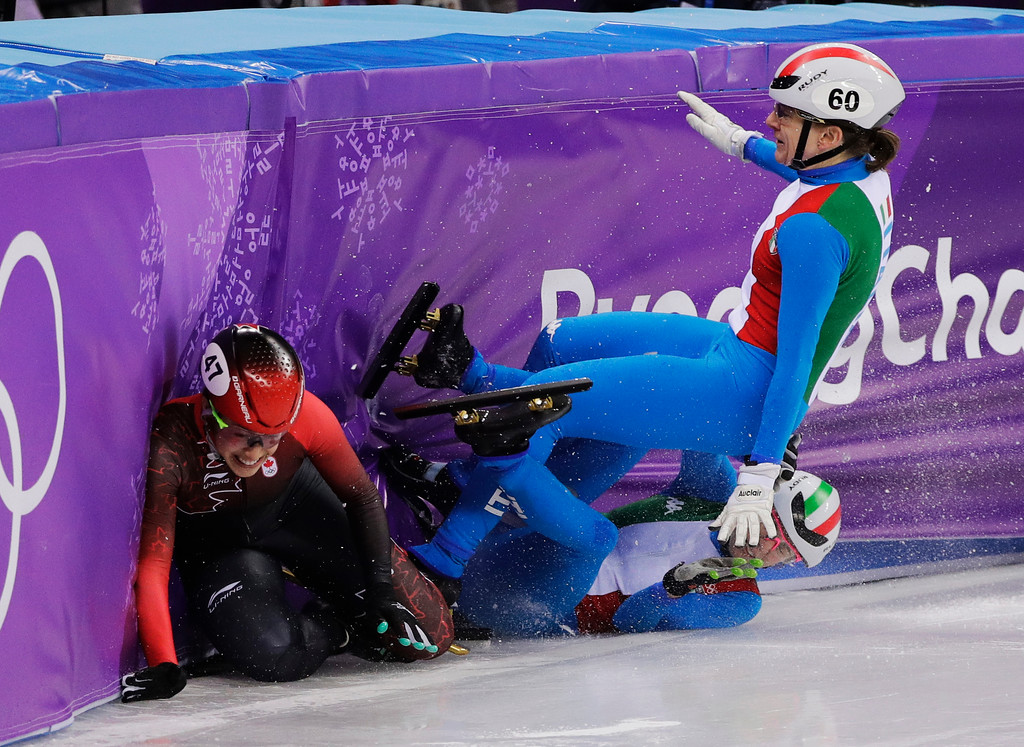 . Italy\'s Lucia Peretti and Cecilia Maffei collide with Canada\'s Valerie Maltais during their women\'s 3000 meters short track speedskating relay A final in the Gangneung Ice Arena at the 2018 Winter Olympics in Gangneung, South Korea, Tuesday, Feb. 20, 2018. (AP Photo/David J. Phillip)