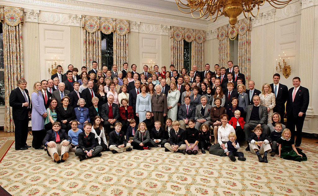 . In the handout photo provided by the White House, President Bush, Laura Bush, former President George H. W. Bush, and former First Lady Barbara Bush pose for a portrait with members of their extended family in the East Room of the White House, Wednesday, Jan. 19, 2005.   (AP Photo/The White House, Eric Draper)