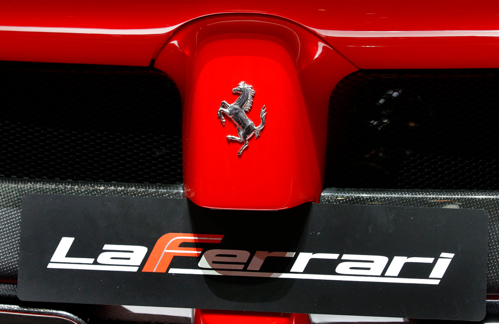 . The back of new LaFerrari hybrid car is pictured on the Ferrari stand during the first media day of the 83rd Geneva Car Show at the Palexpo Arena in Geneva March 5, 2013. The Geneva Motor Show will take place from March 7 to 17, 2017. REUTERS/Denis Balibouse