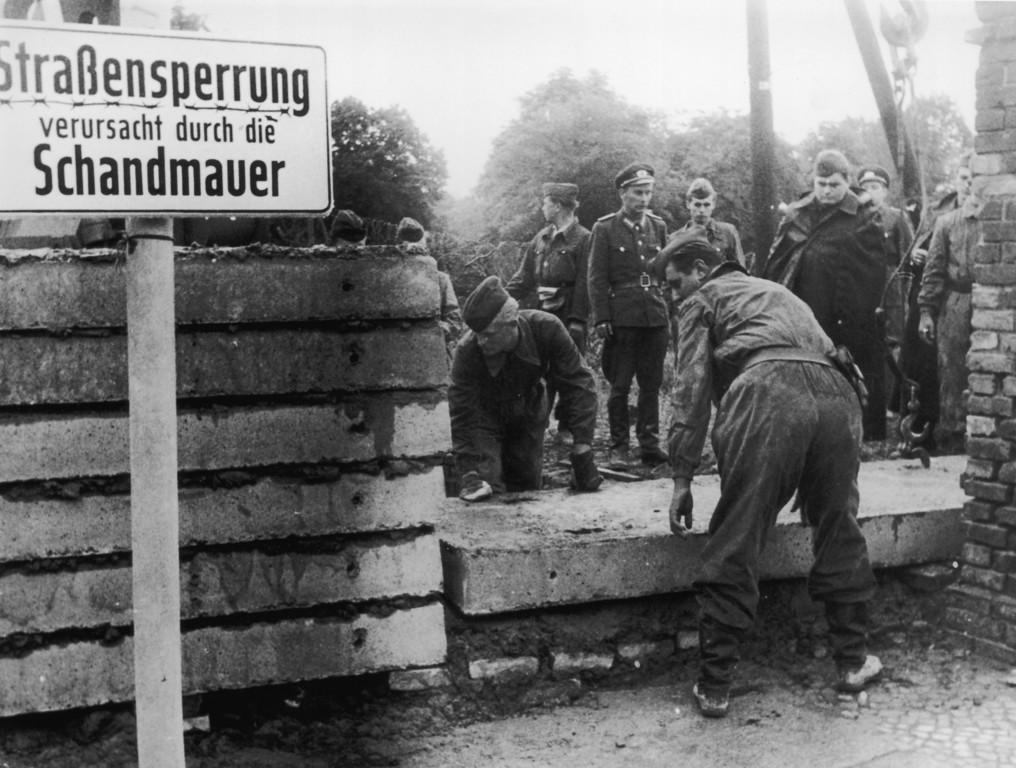 . Soldiers building the Berlin Wall as instructed by the East German authorities, in order to strengthen the existing barriers dividing East and West Berlin, 1961.  (Photo by Keystone/Getty Images)