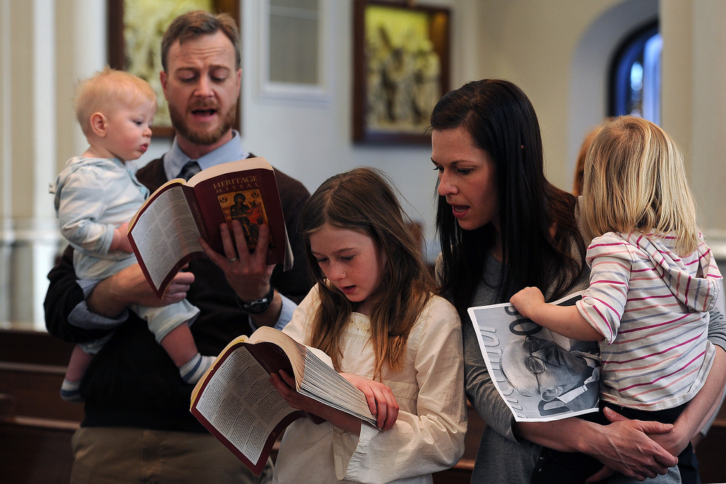 . DENVER, CO- MARCH 13:   Troy and Jenny Freedman brought their children, from left to right, Abel, 7 months (in Troy\'s arms) Evelyn, 8, middle, and Mercy, 2, to the cathedral to celebrate the announcement of the new pope.  An afternoon mass was held at the Cathedral Basilica of the Immaculate Conception in Denver, CO on March 13th, 2013 after the announcement of the new pope. Jorge Mario Bergoglio, who will be called Francis, will be the 266th pontiff of the Roman Catholic Church. He is also the first non-European pope in more than 1,200 years and the first member of the Jesuit order to lead the church. (Photo By Helen H. Richardson/ The Denver Post)