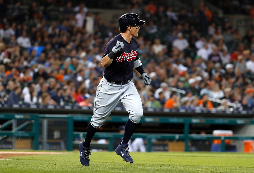 . Cleveland Indians\' Brandon Guyer watches  his three-run home run against the Detroit Tigers in the eighth inning of a baseball game in Detroit, Friday, July 27, 2018. (AP Photo/Paul Sancya)