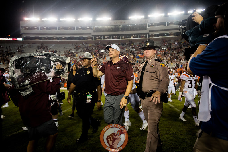 Justin Fuente walks toward midfield to shake hands with Florida State head coach Willie Taggart after the matchup between Virginia Tech and Florida State at Doak Campbell Stadium, Monday, Sept. 3, 2018. (Photo by Cory Hancock)