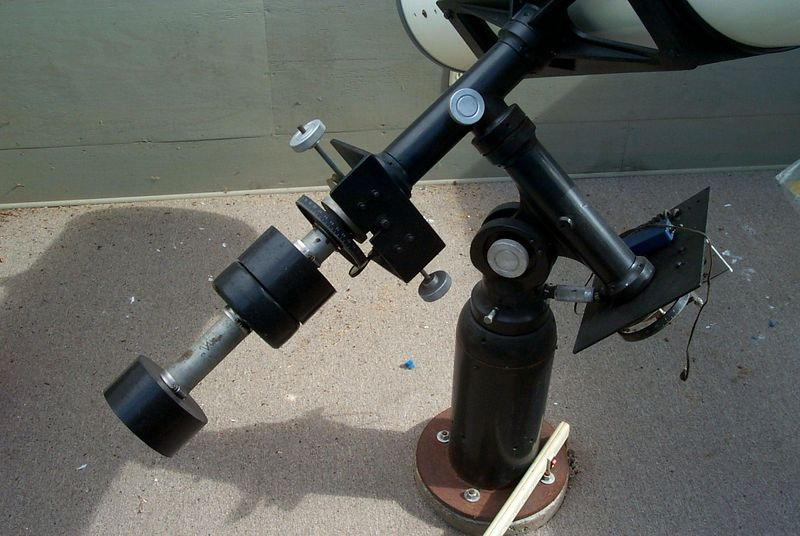 """14.25 inch Equatorial Telescope mount.  This image shows the rather large and heavy mount. The diameters of the axises are 2 inch solid steel. The picture also shows both setting circles that are used for finding a stars """"longitude"""" and """"latitude"""" in the sky.  Three """"heavy"""" counter weights on the Declination axis balences the very heavy telescope tube.  The entire telescope is carefully balanced. You can easily move the entire instrument from star to star with one hand!"""