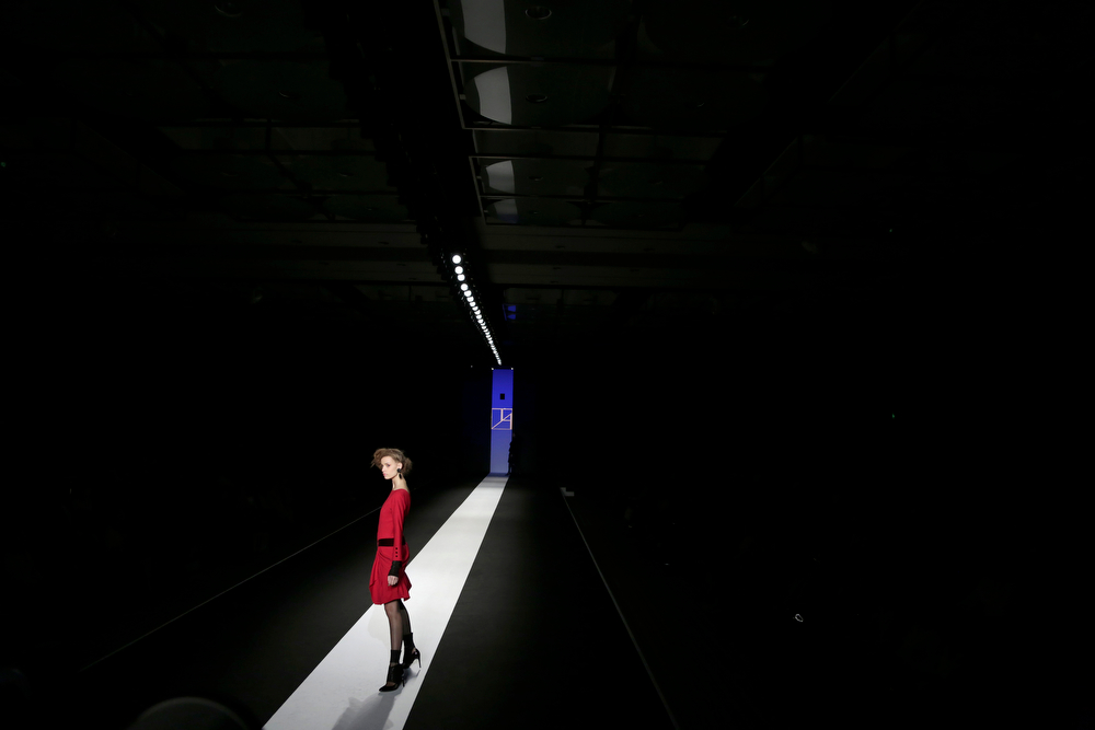 . A model displays a creation from Japanese designer Tae Ashida\'s 2014-2015 Autumn/Winter collection at Tokyo Fashion Week in Tokyo, Wednesday, March 19, 2014. (AP Photo/Shizuo Kambayashi)