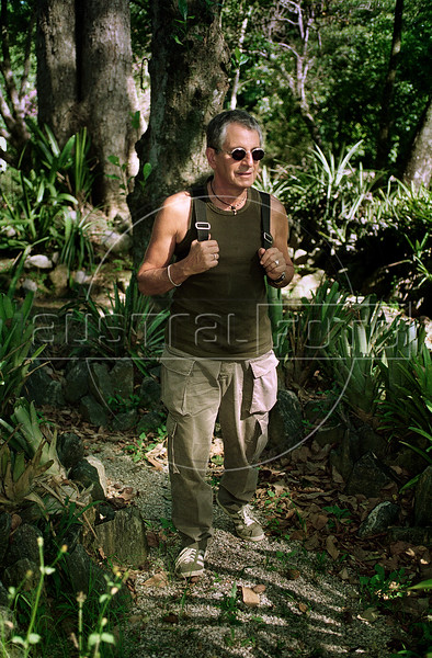 """Brazilian politician, author and journalist Fernando Gabeira walk past by Botanic Garden (Jardim Botanico), Rio de Janeiro, Brazil, January 23, 1998. Gabeira, who was involved in the 1969 kidnapping of the US ambassador to Brazil, is disputing a run-off election as the Green Party (PV) candidate for Rio de Janeiro mayor with Eduardo Paes of the Brazilian Democratic Movement Party (PMDB). Gabeira has been a Federal Deputy since 1995 and is a founding member of the PV. He left the PV in 2002 to join the Worker's Party (PT), of Brazil's president Luiz Inacio Lula da Silva, but later rejoined the PV. He wrote a book about his experience in ambassador kidnapping which later became the 1997 film called """"Four Days in September"""" . (Austral Foto/Renzo Gostoli)"""