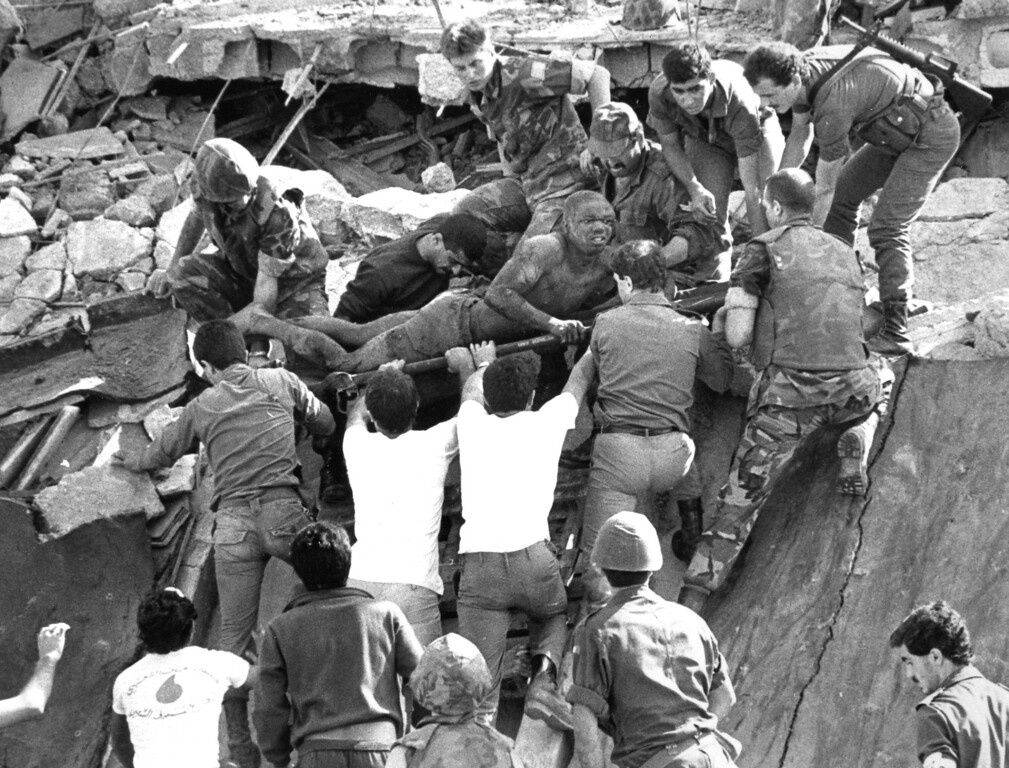 . In this Oct. 23, 1983 file photo, British soldiers give a hand in rescue operations at the site of the bomb-wrecked U.S. Marine command center near the Beirut airport, Lebanon. A bomb-laden truck drove into the center collapsing the entire four story building. The blast _ the single deadliest attack on U.S. forces abroad since World War II _ claimed the lives of 241 American service members. (AP Photo/Bill Foley, File)