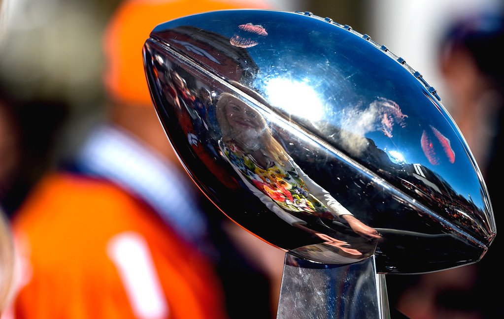 . DENVER, CO - FEBRUARY 09: Annabel Bowlen is reflected in the Super Bowl Trophy as she holds it during the celebration. The Denver Broncos celebrated their Super Bowl victory with a  a parade and celebration February 9, 2016 at the City & County Building. (Photo By John Leyba/The Denver Post)