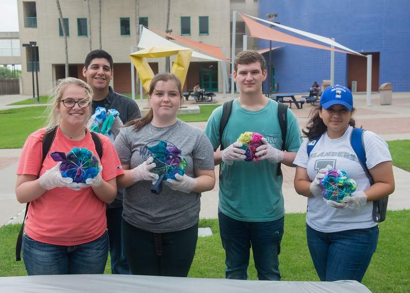 Students showing off their tie-dyed lab coats, event courtesy of the Chemistry Club.