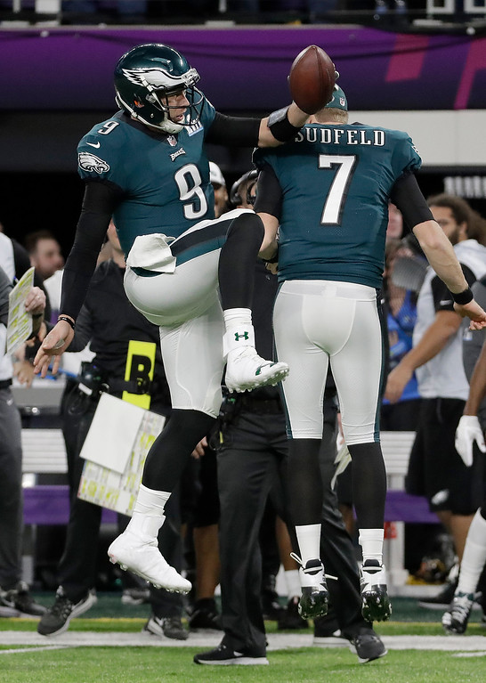 . Philadelphia Eagles quarterback Nick Foles celebrates his touchdown catch with Nate Sudfeld (7) during the first half of the NFL Super Bowl 52 football game against the New England Patriots Sunday, Feb. 4, 2018, in Minneapolis. (AP Photo/Mark Humphrey)