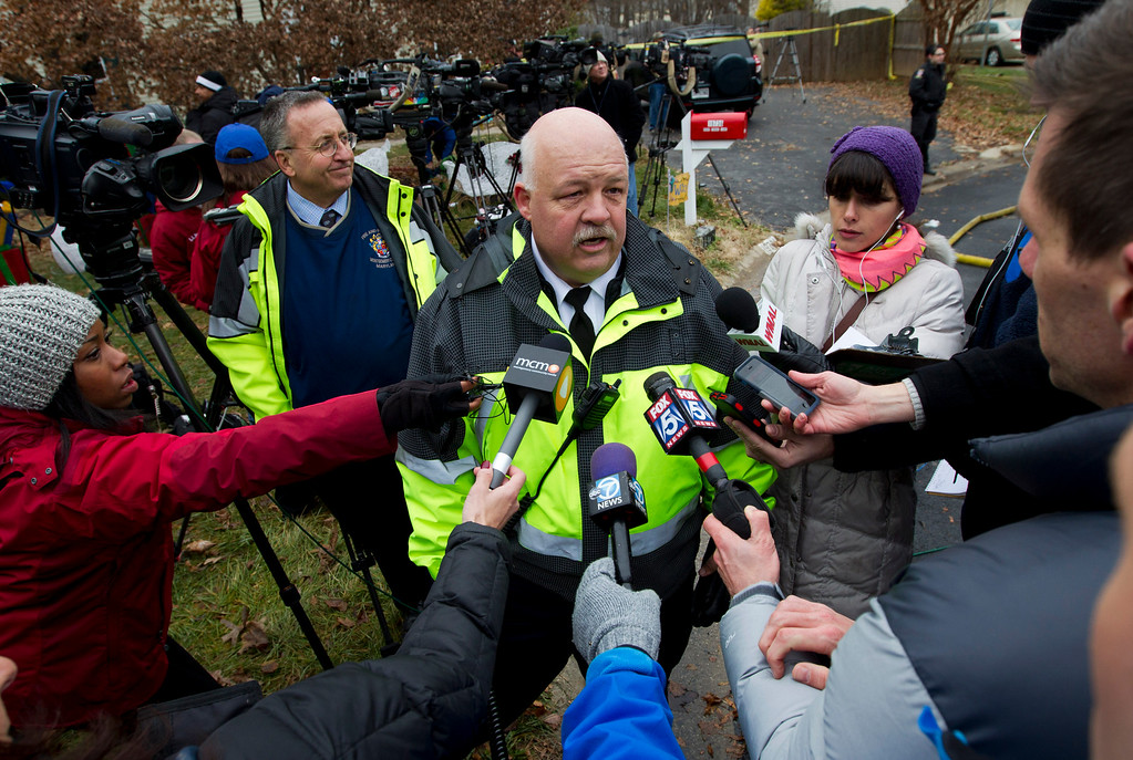 . Montgomery County, Md. Fire and Rescue Chief Steve Lohr speaks to the media near where a small private jet crashed into a house in Gaithersburg, Md., Monday, Dec. 8, 2014. A woman and her two young sons inside the home and three people on the aircraft were killed, authorities said. (AP Photo/Jose Luis Magana)