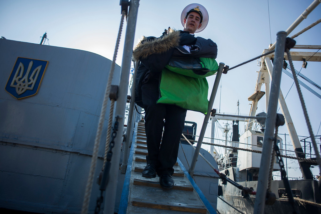 . A crew member of  the Ukrainian corvette Khmelnitsky leaves the ship which has been seized by pro-Russian forces in Sevastopol, Crimea, Thursday, March 20, 2014. (AP Photo/Andrew Lubimov)