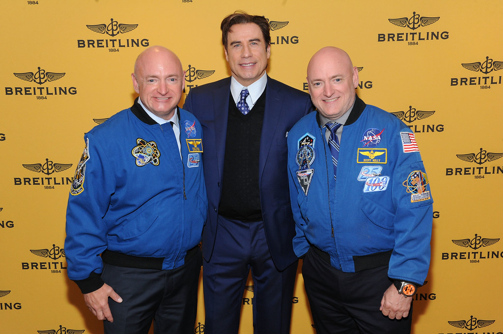 . Mark Kelly, John Travolta and Scott Kelly attend the Breitling Boutique New York Grand Celebration on May 19, 2016 in New York City.  (Photo by Craig Barritt/Getty Images for Breitling USA)
