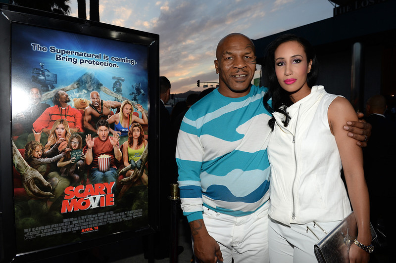 ". Actor Mike Tyson (L) and Lakiha Spicer arrive for the premiere of Dimension Films\' ""Scary Movie 5\"" at ArcLight Cinemas Cinerama Dome on April 11, 2013 in Hollywood, California.  (Photo by Michael Buckner/Getty Images)"