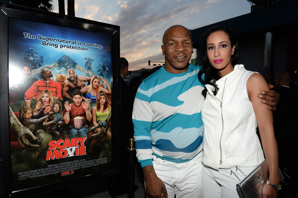 """. Actor Mike Tyson (L) and Lakiha Spicer arrive for the premiere of Dimension Films\' \""""Scary Movie 5\"""" at ArcLight Cinemas Cinerama Dome on April 11, 2013 in Hollywood, California.  (Photo by Michael Buckner/Getty Images)"""