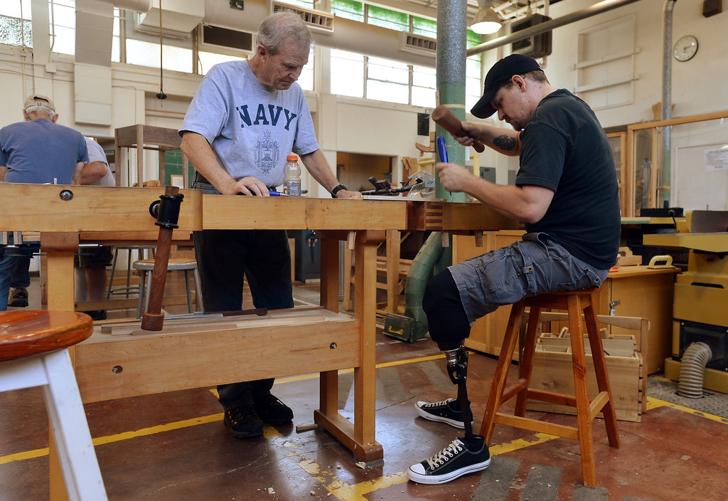 . Diablo Woodworkers instructor David Lipscomb, left, works with Noah Bailey on a table project in Pleasant Hill, Calif. on Wednesday, July 24, 2013. The Diablo Woodworkers are reaching out to military veterans like Bailey and emphasizing the therapeutic qualities of woodworking. (Kristopher Skinner/Bay Area News Group)