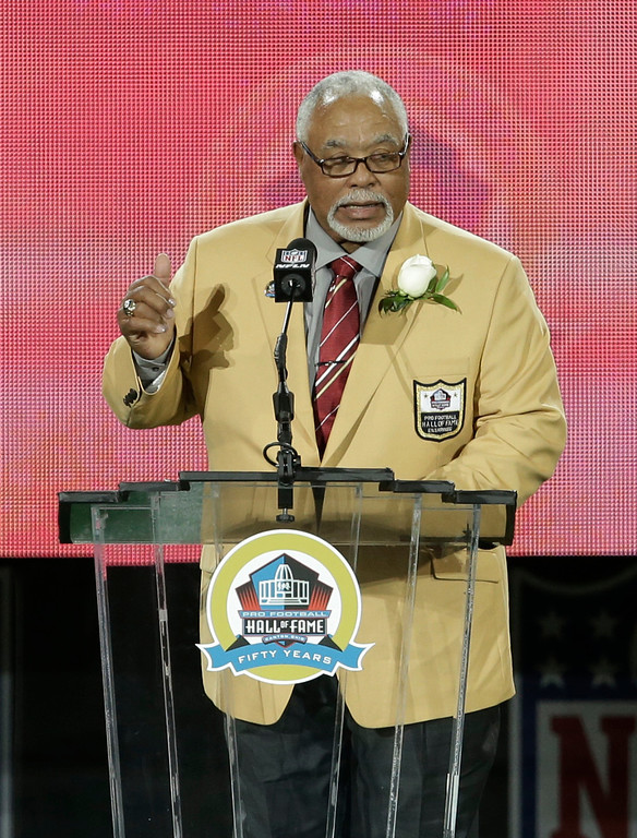 . Former NFL football player Curley Culp speaks during the induction ceremony at the Pro Football Hall of Fame Saturday, Aug. 3, 2013, in Canton, Ohio. (AP Photo/Tony Dejak)