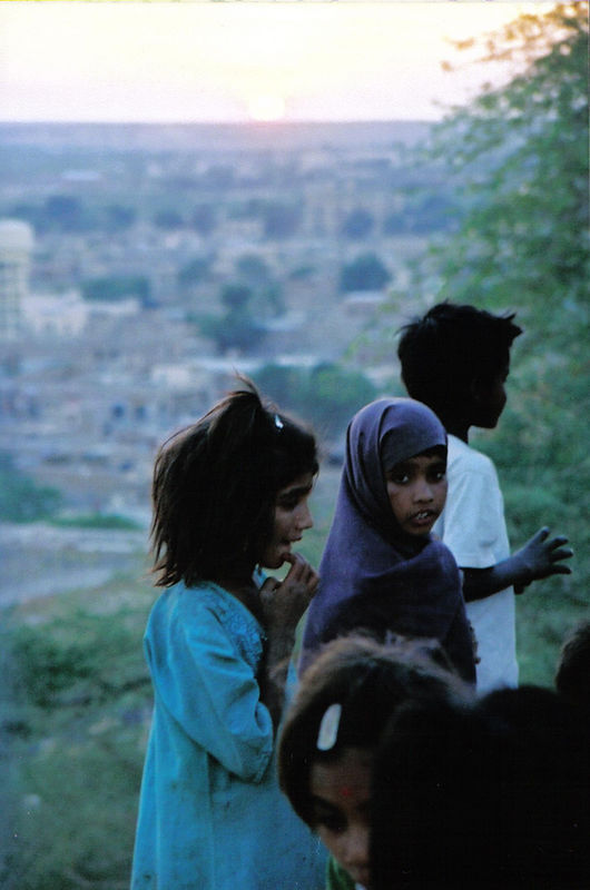 children living in homemade hill dwellings, Rajasthan