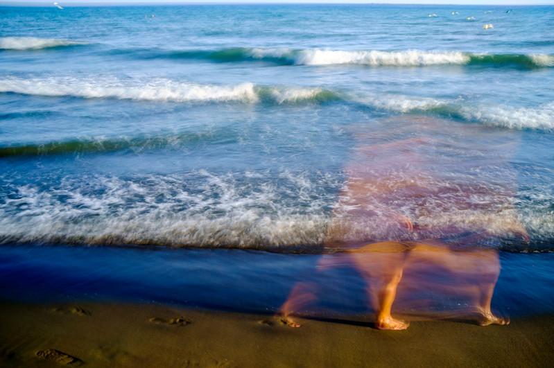 Long exposure shot of a person walking on the beach, Malaga, Spain