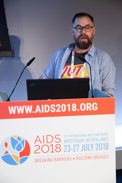 The Netherlands, Amsterdam, 25-7-2018. Meeting of the Asia-Pacific regional department of IAS.Unknown member of the audience came on the spekers stand to answer a question on issues involving AIDS2020.Photo: Rob Huibers for IAS. (Please publish always with complete attribution).