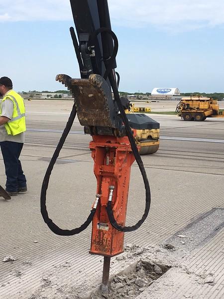 NPK GH1 hydraulic hammer on Deere 35G mini excavator - Murphy doing repairs at Cleveland airport 2017 (1).jpg