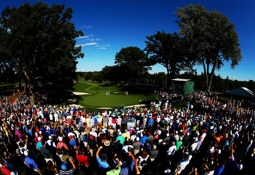 . ROCHESTER, NY - AUGUST 10:  A gallery of fans watch as Henrik Stenson of Sweden makes a putt for birdie on the 13th green during the third round of the 95th PGA Championship on August 10, 2013 in Rochester, New York.  (Photo by Streeter Lecka/Getty Images)