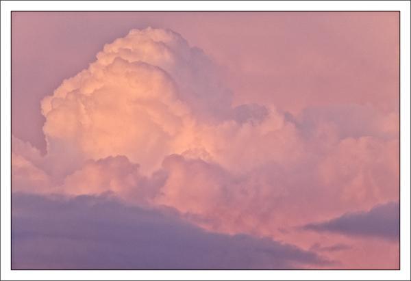 Pink Cumulus Clouds at Sunset