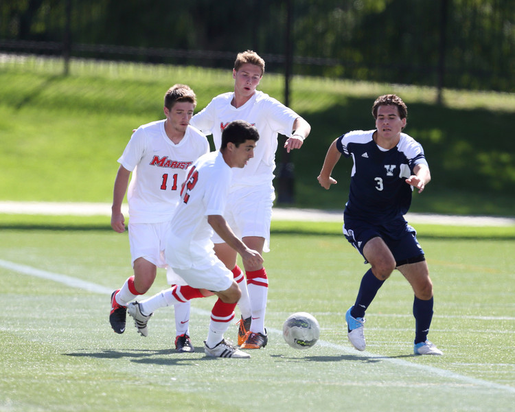 POUGHKEEPSIE, NY - SEPTEMBER 23: Anthony Rozmus #12 passes ball during Yale verses Marist Soccer on September 23, 2012 at Tenney Stadium in Poughkeepsie New York.  Yale defeats Marist 2-1. (Photo by Sandy Tambone)