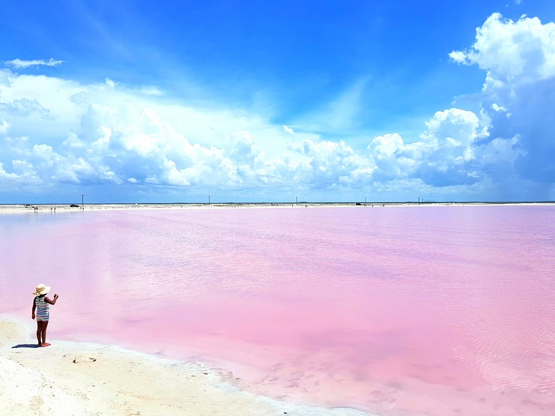 Little girl and salt pink lagoon in Las Coloradas, Yucatan, Mexico.
