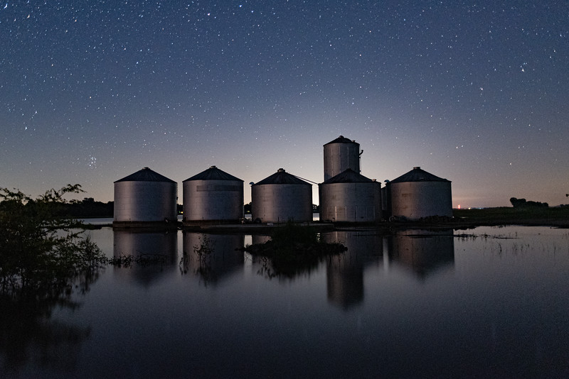 Flooded Grain Silos Under the Stars