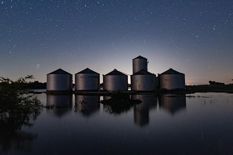 Flooded Grain Silos Under the Stars