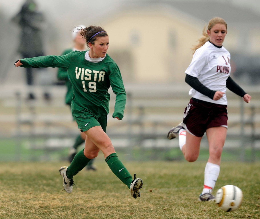 . Mountain Vista forward Kelsey Luke (19) put a shot on net in the second half. The Mountain Vista High School girl\'s soccer team defeated Ponderosa 6-0 Tuesday night, April 2, 2013.  Photo By Karl Gehring/The Denver Post)