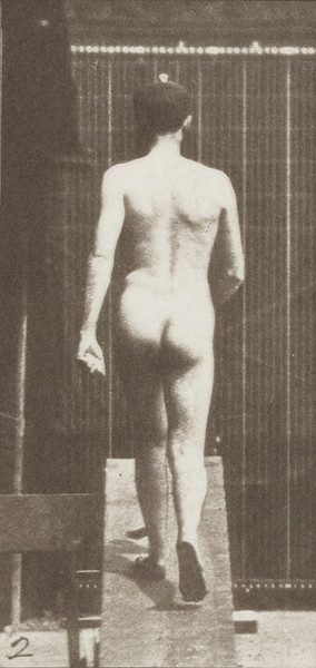 Nude male ascending an incline