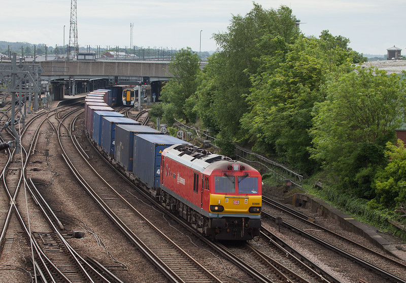 EWS 92009 with an intermodal passes through Ashford, Kent.